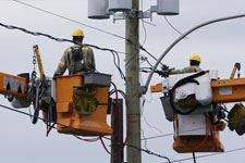 Electricl outage men in cherry pickers